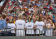 """Aug. 21. 2015 Mobile, AL, Trump supporters at his campaign pep rally in Ladd Peebles Stadium. These women are all party of the Republican Party and plan to vote for Trump. The front of their shirts spelled out Trump's slogan """"Make America Great Agian"""", the back, """"Obama You Are Fired.""""<br /> Over 20 thousand came to the Ladd-Peebles Stadium to attend Trumps campaign pep rally. 40,000 were expected to come."""