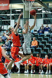 BLOOMINGTON, IL - December 15: Jason Gregoire and Tyler Ingebrigtsen during a college basketball game between the IWU Titans  and the Carroll Pioneers on December 15 2018 at Shirk Center in Bloomington, IL. (Photo by Alan Look)