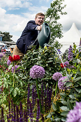 To mark it's centenary, the Commonwealth War Graves Commision (CWGC) has teamed up with Glen Art and the Wilfred Owen Association to create a remembrance garden at the annual Gardening Scotland event. Robert Ross from the CWGC is pictured keeping the plants well watered.<br /> <br /> © Dave Johnston/ EEm
