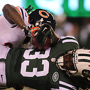 Chris Ivory, New York Jets, is tackled by Tim Jennings, Chicago Bears in action during the New York Jets Vs Chicago Bears, NFL regular season game at MetLife Stadium, East Rutherford, NJ, USA. 22nd September 2014. Photo Tim Clayton for the New York Times
