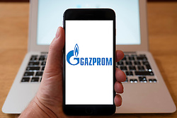 Using iPhone smartphone to display logo of Gazprom, Russian oil and gas company