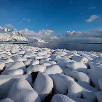 Snow covered rocks near coast, Hamnøy, Moskenesøy, Lofoten Islands, Norway