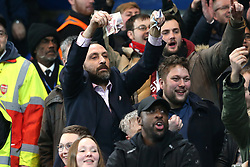 10 January 2018 - Football League Cup - Chelsea v Arsenal - An Arsenal fan mocks the affluence of Chelsea FC by waving £50 notes at Chelsea fans - Photo: Charlotte Wilson / Offside