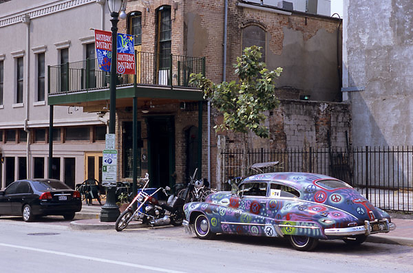 Stock photo of a classic peace car parked street side in downtown