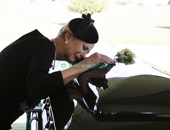 September 1, 2018 - Annapolis, Maryland, U.S. - In this hand-out photo released by the McCain family, CINDY MCCAIN lays her head on the casket of Sen. John McCain, R-Ariz., during a burial service at the cemetery at the United States Naval Academy in Annapolis, Md., on Sunday, Sept. 2, 2018. .Credit: David Hume Kennerly / McCain Family via CNP (Credit Image: © David Hume Kennerly/CNP via ZUMA Wire)