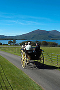 A jaunting car passes by Lough Lein, Killarney's Lower Lake on a trip around the Muckross Demesne in Killarney National Park.<br /> Picture by Don MacMonagle