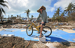 Billy Quinn sits on his bike and the concrete slab where his trailer once stood at the Seabreeze trailer park along the Overseas Highway in the Florida Keys on Tuesday, September 12, 2017. Photo by Al Diaz/Miami Herald/TNS/ABACAPRESS.COM