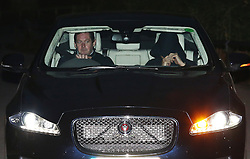 © Licensed to London News Pictures. 17/12/2015. Cobham, UK.A person believed to be Jose Mourinho (R) covers up as he leaves Chelsea FC training ground after being sacked.  Photo credit: Peter Macdiarmid/LNP