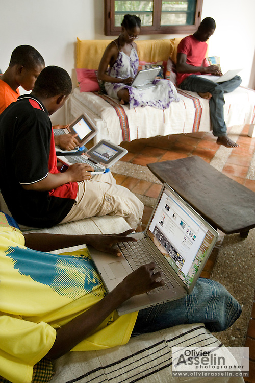 Students use laptops to browse the internet over a wireless network at the Kokrobitey Institute in the town of Kokrobitey, 30km west of Ghana's capital Accra on Sunday January 18, 2009. From bottom clockwise Patrick Tetteh Tamatey, Reuben Sekpona, Abass Aryee, Nana Ama Bentsi-Enchill, Simon Mensah.