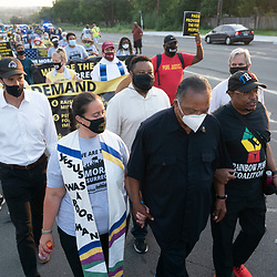 Faith leaders headed by legendary Democratic activist JESSE JACKSON (in black) as voting rights groups march toward the Texas Capitol from north Austin on the third day of a 30-mile journey protesting Republican efforts to suppress votes nationwide and in Texas. Shifts of marchers trade off in an effort to combat oppressive Texas heat.