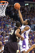 Kansas State guard Akeem Wright (R) scores past Colorado's Julius Ashby (L) during the second half of the Wildcats 72-60 win over the Buffaloes at Bramalage Coliseum in Manhattan, Kansas, February 18, 2006.