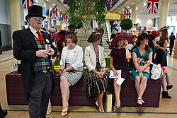 © London News Pictures. 20/06/2013. Ascot, UK. People rest in the royal stand. Ladies Day on day three of Royal Ascot at Ascot racecourse in Berkshire, on June 20, 2013. The 5 day showcase event, which is one of the highlights of the racing calendar, has been held at the famous Berkshire course since 1711 and tradition is a hallmark of the meeting. Top hats and tails remain compulsory in parts of the course.  Photo credit : Stephen Simpson/LNP