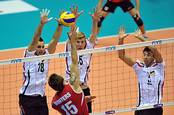 27.09.2010, Palatriest, Triest, ITA, Volleyball Weltmeisterschaft 2010, Vorrunde, Deutschland ( GER ) vs. Kanada ( CAN ), im Bild Frederic Winters (#15 CAN) - Georg Grozer (#18 GER / Rzeszow POL), Max Guenthoer (#15 GER / Haching GER), Bjoern Andrae (#5 GER / Kemerovo RUS). EXPA Pictures © 2010, PhotoCredit: EXPA/ nph/  Conny Kurth +++++ ATTENTION - OUT OF GERAMANY / GER +++++