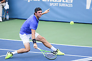 TOMMY PAUL hits a low backhand during his second round match at the Citi Open at the Rock Creek Park Tennis Center in Washington, D.C.