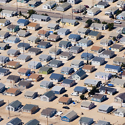 Aerial view of New Jersey Beach ocean front neighborhood following storm surge  with sand covering streets and doors, high levels of ocean sand. DRONE VIEW OF HOUSES
