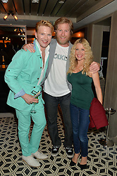 Left to right, HENRY CONWAY, WARREN SMITH and MELINDA MESSENGER at Henry Conway's 31st birthday party held at the Pont St Restaurant, Belgraves Hotel, London on 12th July 2014.