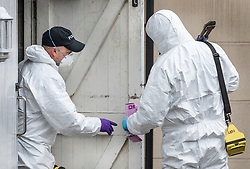 © Licensed to London News Pictures. 05/01/2019. Farnham, UK. Police forensics officers search a rubbish bin cupboard next to a property in Farnham, Surrey after a couple were arrested in connection with the murder of a man on a train yesterday. A murder investigation has been launched after the man was attacked while on board the 12. 58pm train service travelling between Guildford and London Waterloo. A man and a woman have been detained by police in Farnham in connection with the murder. Photo credit: Peter Macdiarmid/LNP