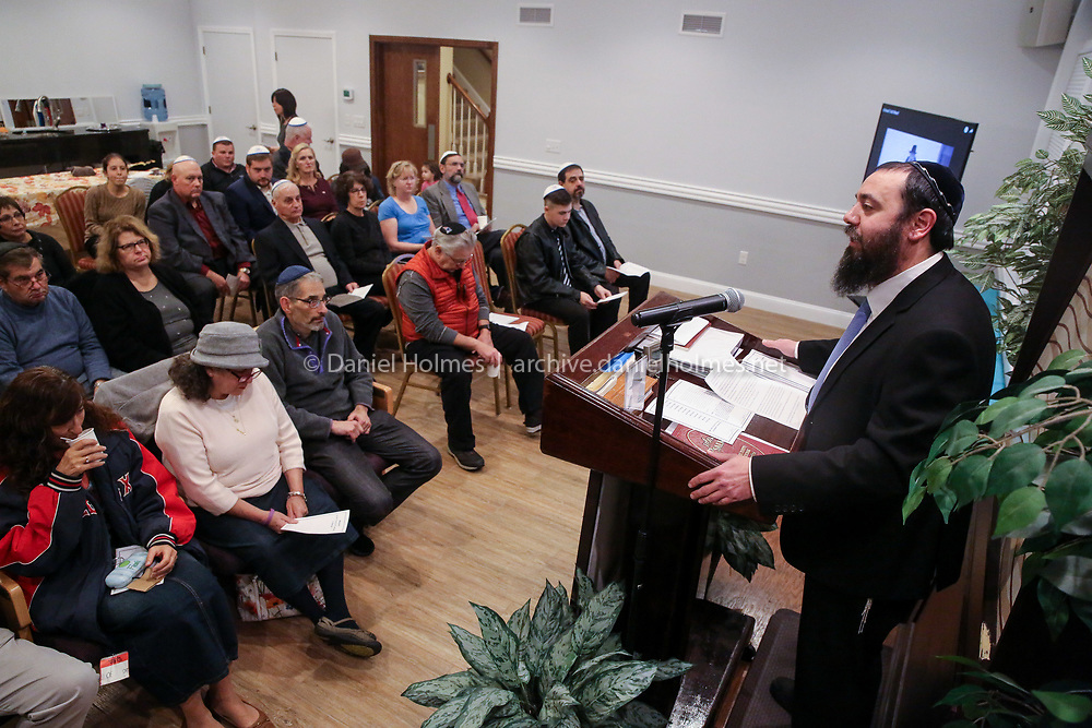 (10/28/18, MILFORD, MA) Rabbi Mendy Kivman speaks during a memorial and moment of Torah at Chabad House Jewish Center in Milford on Sunday. The memorial will be held to honor the 11 people killed and those who were injured at the Tree of Life Synagogue in Pittsburgh. [Daily News and Wicked Local Photo/Dan Holmes]
