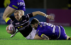Leeds Rhino's Jack Walker is tackled by Warrington's Daryl Clark during the Betfred Super League match at the Halliwell Jones Stadium, Warrington.