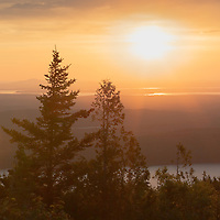 A dreamy dusk creates a warm glow at the Blue Hill Overlook in Acadia National Park, Maine.