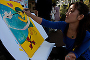Artist, Rena Masuya paints at an Anti nuclear protest by women outside the Ministry of Economy, Trade and Industry (METI) in Tokyo Japan. Friday November 4th 2011. The protest ran from October 27th to Noverber 5th. Originally started my mothers from Fukushima protesting about nuclear contamination from October 30th to November 5th the protest welcomed women and people from all over Japan.