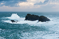 Large winter waves crash against rocks at Butt of Lewis, Isle of Lewis, Outer Hebrides, Scotland