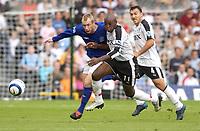 Photo: Daniel Hambury.<br /> Fulham v Everton. The Barclays Premiership.<br /> 27/08/2005.<br /> Fulham's Luis Boa Morte and Everton's Tony Hibbert chase the ball.