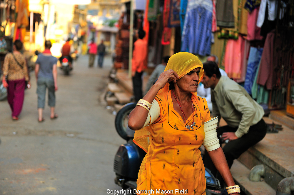 Woman with traditional camel bone arm bangles in Jaisalmer