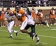Oct 23, 2010; Charlottesville, VA, USA;  Virginia Cavaliers wide receiver Dontrelle Inman (81) is covered well by Eastern Michigan Eagles cornerback Arrington Hicks (19) during the 1st half of the game at Scott Stadium.  Mandatory Credit: Andrew Shurtleff