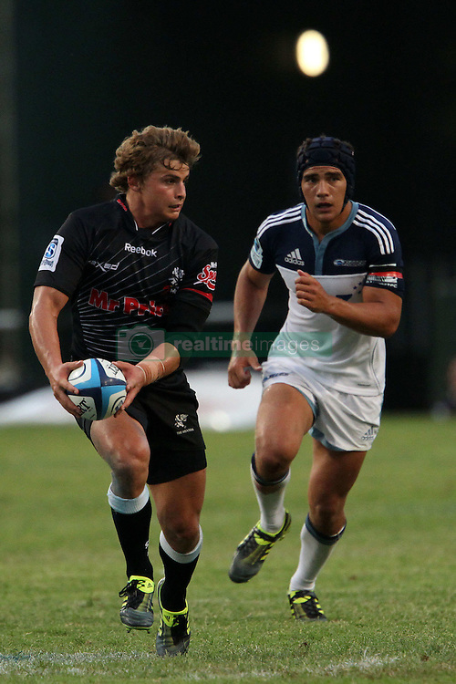 Patrick Lambie of The Sharks looks to release the ball during the Super15 match between The Mr Price Sharks and The Blues held at Mr Price Kings Park Stadium in Durban on the 26th February 2011..Photo By:  Ron Gaunt/SPORTZPICS
