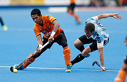 Razie Rahim of Malaysia (left) and Matias Paredes of Argentina during the Men's World Hockey League, semi-final match at Lee Valley Hockey Centre, London.