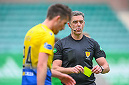 Referee Greg Aitken flashes a yellow card during the SPFL Premiership match between Hibernian and St Johnstone at Easter Road Stadium, Edinburgh, Scotland on 1 May 2021.