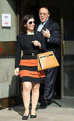 © London News Pictures. 14/08/2012. London, UK. Cypriot businessman Asil Nadir leaving The Old Bailey, in London with his wife Nur Nadir (left) on August 14, 2012 where the jury is currently considering a verdict  in the Polly Peck fraud case. Nadir, who fled to Cyprus in 1993 after the charges were first brought, is accused of £34m fraud at his firm Polly Peck. Photo credit : Ben Cawthra/LNP