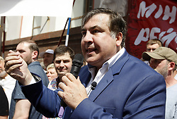 May 30, 2017 - Kiev, Ukraine - Ex-Georgian president and former Odessa regional governor Mikheil Saakashvili speaks during a rally of his supporters near the Justice Ministry, in Kiev, Ukraine, 30 May, 2017. Protesters demanded from the Ministry of Justice to register the political party ''The movement of new strengths'' of the Mikheil Saakashvili and cancel registration of the fake party with the same name reading like ''The block of Mikheil Saakashvili'', as local media reported. (Credit Image: © Str/NurPhoto via ZUMA Press)