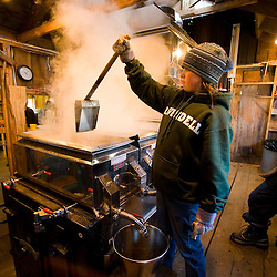 Megan Perkins tends the sap evaporator at the Fifield's Sugarhouse in Strafford, Vermont.
