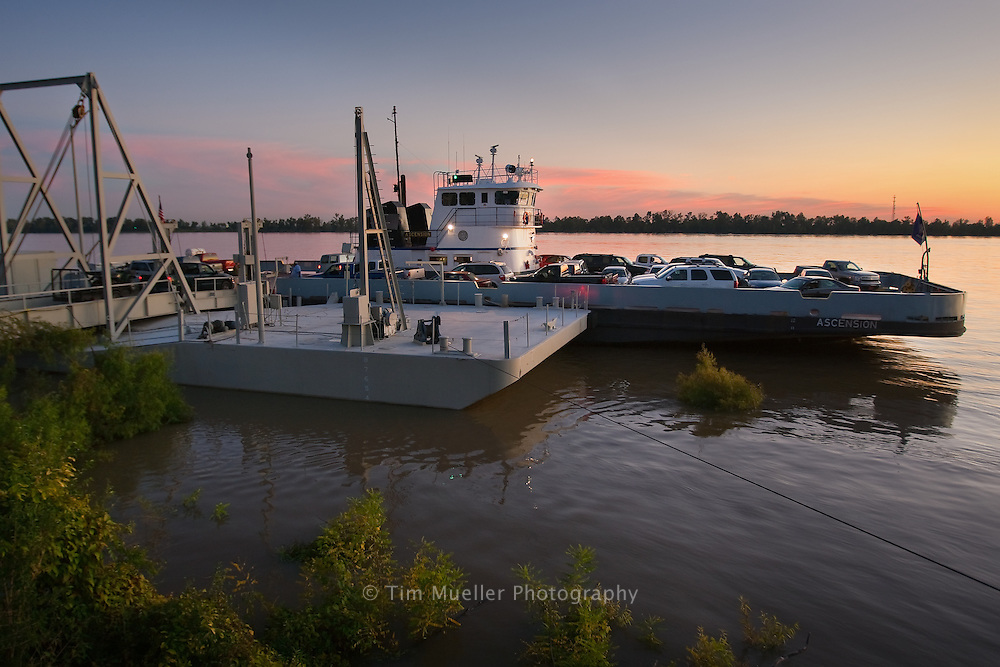 Westbound traffic fills the Plaquemine Ferry to cross the Mississippi River to the city of Plaquemine.