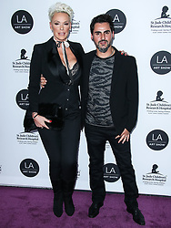 LOS ANGELES, CA, USA - JANUARY 23: Los Angeles Art Show 2019 Opening Night Gala held at the Los Angeles Convention Center on January 23, 2019 in Los Angeles, California, United States. 23 Jan 2019 Pictured: Brigitte Nielsen, Mattia Dessi. Photo credit: Xavier Collin/Image Press Agency / MEGA TheMegaAgency.com +1 888 505 6342