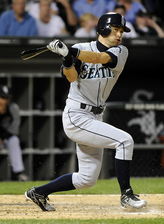 CHICAGO - JUNE 06:  Ichiro Suzuki #51 of the Seattle Mariners bats against the Chicago White Sox on June 6, 2011 at U.S. Cellular Field in Chicago, Illinois.  The White Sox defeated the Mariners 3-1.  The ball was ruled a hit.  (Photo by Ron Vesely)  Subject:  Ichiro Suzuki