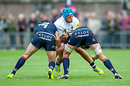 Hamish Watson and Jamie Hodgson of Edinburgh Rugby tackle Zach Mercer of Bath Rugby during the Rugby Friendly match between Edinburgh Rugby and Bath Rugby at Meggetland Sports Complex, Edinburgh, Scotland on 17 August 2018.