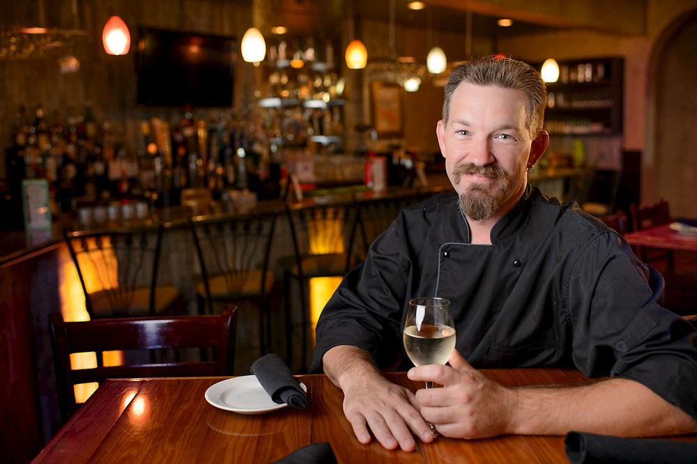 Executive Chef Mark Muller sits for a portrait at one his restaurants in Stuart Florida