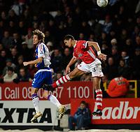 Photo: Sportsbeat<br />Charlton Athletic v Blackburn Rovers. Carling Cup.<br />30/11/2005.<br />Blackburn's Morten Gamst Pedersen (L) challenges Charlton's Talal El Karkouri in the air.