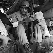 THE SOLDIER OF ARTILLERY OF THE SMP RAYMOND ALAN MONGE IN A BARGE OF PASSENGERS TRANSPORT IN THE RIVER SAN JUAN. NICARAGUA. 1985.