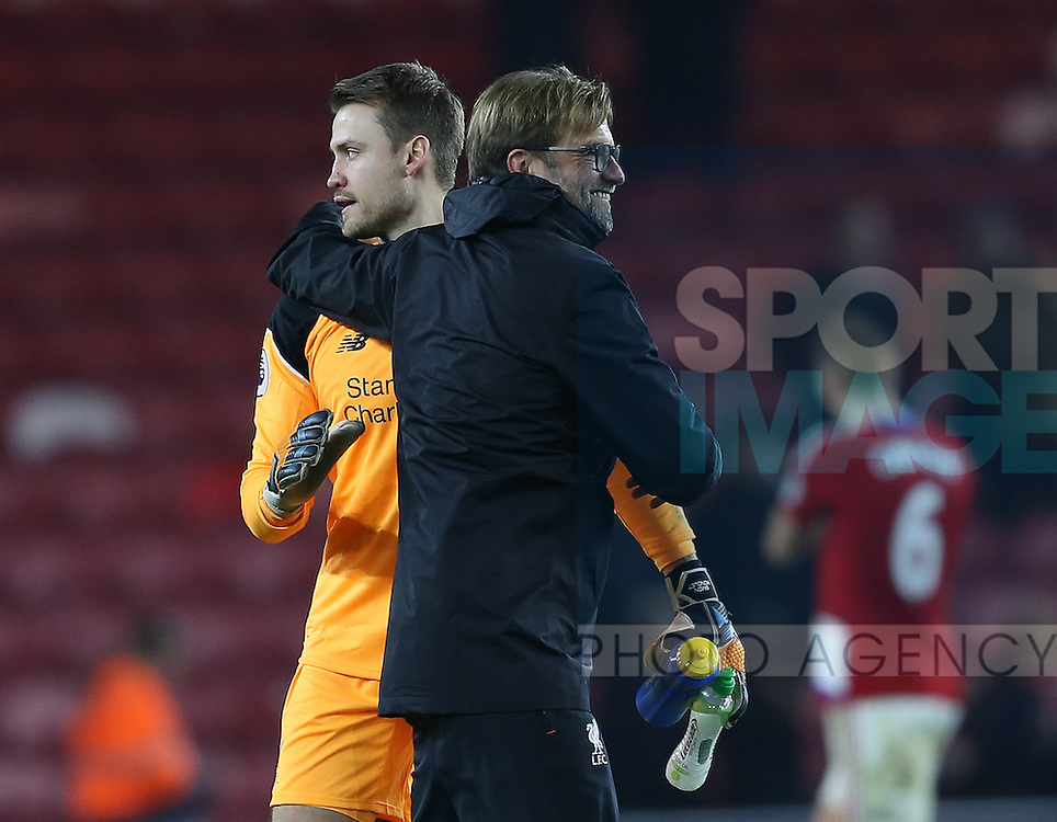 Simon Mignolet of Liverpool hugged by Jurgen Klopp manager of Liverpool during the English Premier League match at the Riverside Stadium, Middlesbrough. Picture date: December 14th, 2016. Pic Simon Bellis/Sportimage
