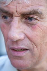 Portrait of an older man looking worried,