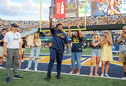Sep 11, 2021; Morgantown, West Virginia, USA; Former West Virginia Mountaineers defensive lineman Darius Stills waives to the crowd during 2020 senior recognition during halftime against the Long Island Sharks at Mountaineer Field at Milan Puskar Stadium. Mandatory Credit: Ben Queen-USA TODAY Sports