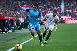 December 16, 2018 - Seville, Andalucia, Spain - Sergio Escudero of Sevilla FC and Pedro Porro of Girona CF competes for the ball during the LaLiga match between Sevilla FC and Girona at Estadio Ramón Sánchez Pizjuán on December 16, 2018 in Seville, Spain  (Credit Image: © Javier MontañO/Pacific Press via ZUMA Wire)