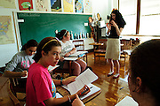 Clare Harper (foreground left) and Mary Kate Cahill (R) discuss the topic at hand in Elizabeth Corinth's (standing) history class at St. Scholastica Academy. Although the shool has officially closed it's doors, a bare bones staff continues to offer a Senior Academy for 26 of it's students. The extension program helps seniors avoid a schools transfer in their final year and a continuation of the school's International Baccalaureate program, a collection of classes not offered at neighboring schools. August 27, 2012 l Brian J. Morowczynski/ViaPhotos.