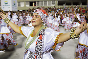 Older female dancers dressed in white, dancing for Salgueiro Samba School doing the final practice performance of their Carnival procession in the Sambadrome, Rio de Janeiro, Brazil