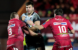 Toulon's Facundo Isa is tackled by Scarlets' Samson Lee<br /> <br /> Photographer Simon King/Replay Images<br /> <br /> European Rugby Champions Cup Round 6 - Scarlets v Toulon - Saturday 20th January 2018 - Parc Y Scarlets - Llanelli<br /> <br /> World Copyright © Replay Images . All rights reserved. info@replayimages.co.uk - http://replayimages.co.uk