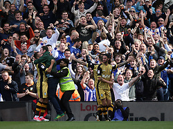 A supporter invades the pitch while Sheffield Wednesday's Steven Fletcher celebrates scoring against Fulham